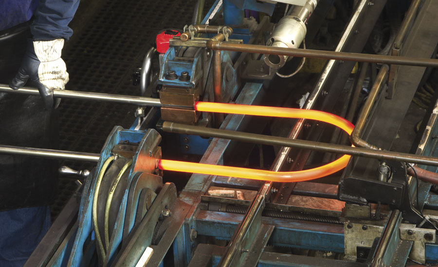 Stress-relieved U-bent duplex stainless steel tubing being manufactured