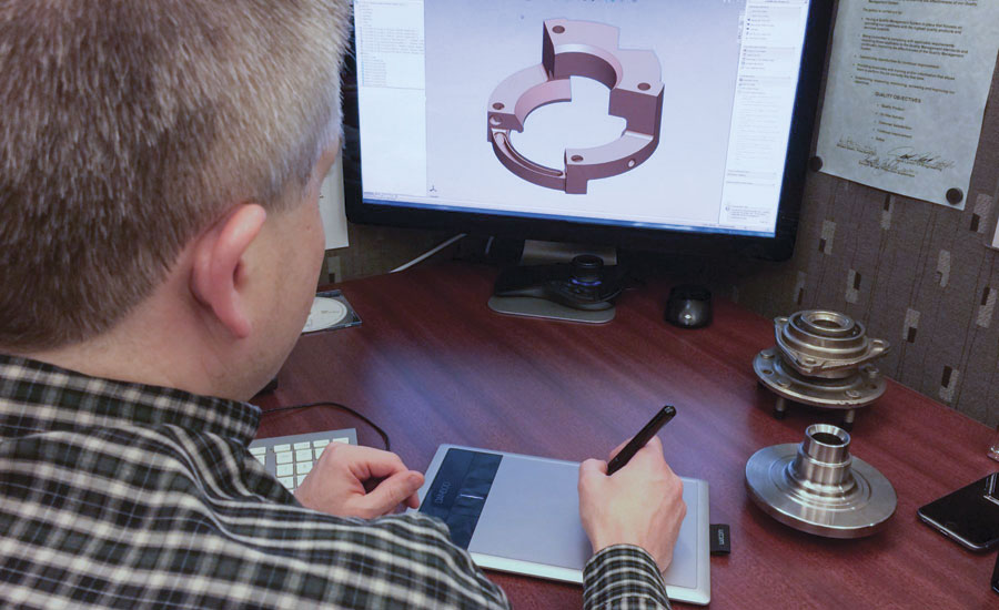A design specialist uses SolidWorks CAD program to design an inductor loop