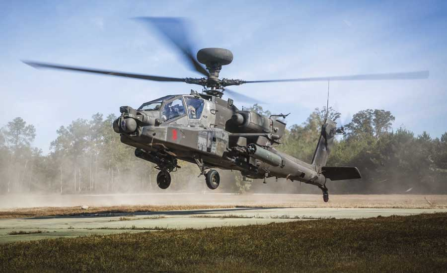 AH-64D Apache helicopter descends for re-arming and refueling