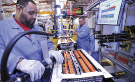 Workers assemble battery packs in the Ford plant in Ypsilanti, Michigan
