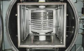 Typical load in a vacuum hot press (VHP) consisting of nine turbine-engine stator nozzles