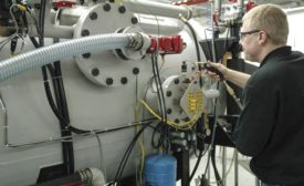 An Ipsen Expert Leak Checking a Vacuum Furnace